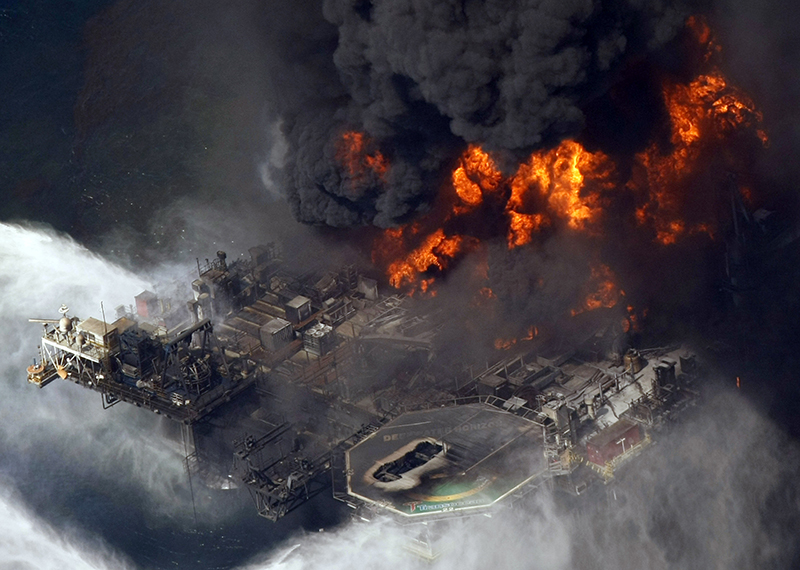FILE - In this April 21, 2010 file aerial photo taken in the Gulf of Mexico more than 50 miles southeast of Venice on Louisiana's tip, the Deepwater Horizon oil rig is seen burning. The Associated Press