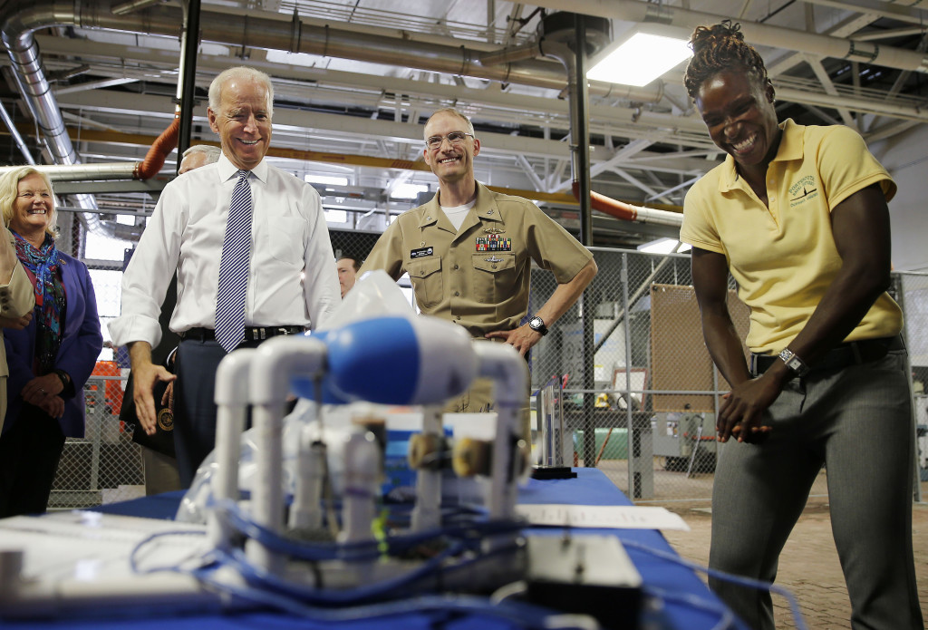 Vice President Joe Biden shares a laugh with shipyard worker Stacy Woodley, right, and shipyard commander Bill Greene, center, at the Portsmouth Naval Shipyard in Kittery on Wednesday.