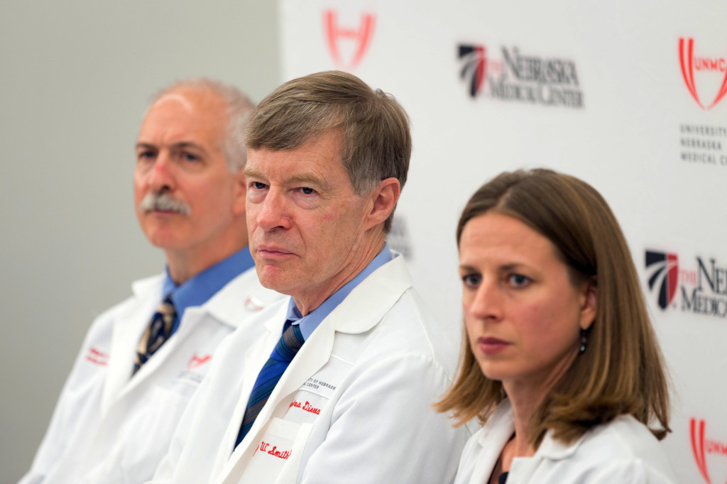 From left, Dr. Mark Rupp, an infectious disease specialist; Dr. Phil Smith, medical director; and Dr. Angela Hewlett, associate medical director, hold a news conference in Omaha, Neb., on Thursday. Doctors at the Nebraska Medical Center said they're ready to treat a missionary who was infected with Ebola while serving in Liberia. The Associated Press