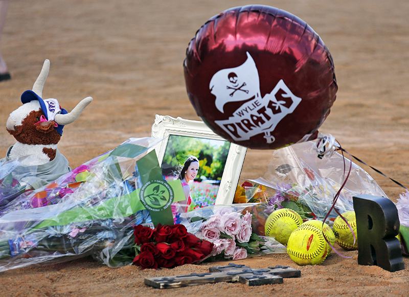 Memorials and flowers were placed on the pitcher's mound at the Wylie (Texas) High School softball field at a vigil held Saturday for Meagan Richardson, 19, one of the softball players killed in a bus crash in Oklahoma on Friday night. The Associated Press