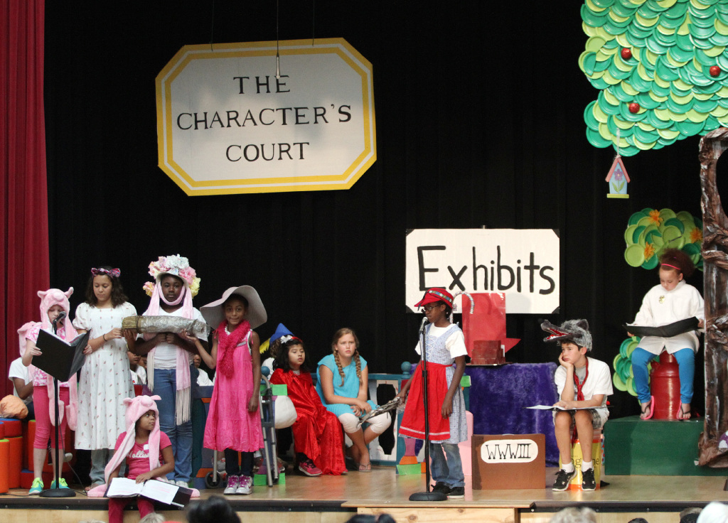 Third-graders fill the stage during a performance of