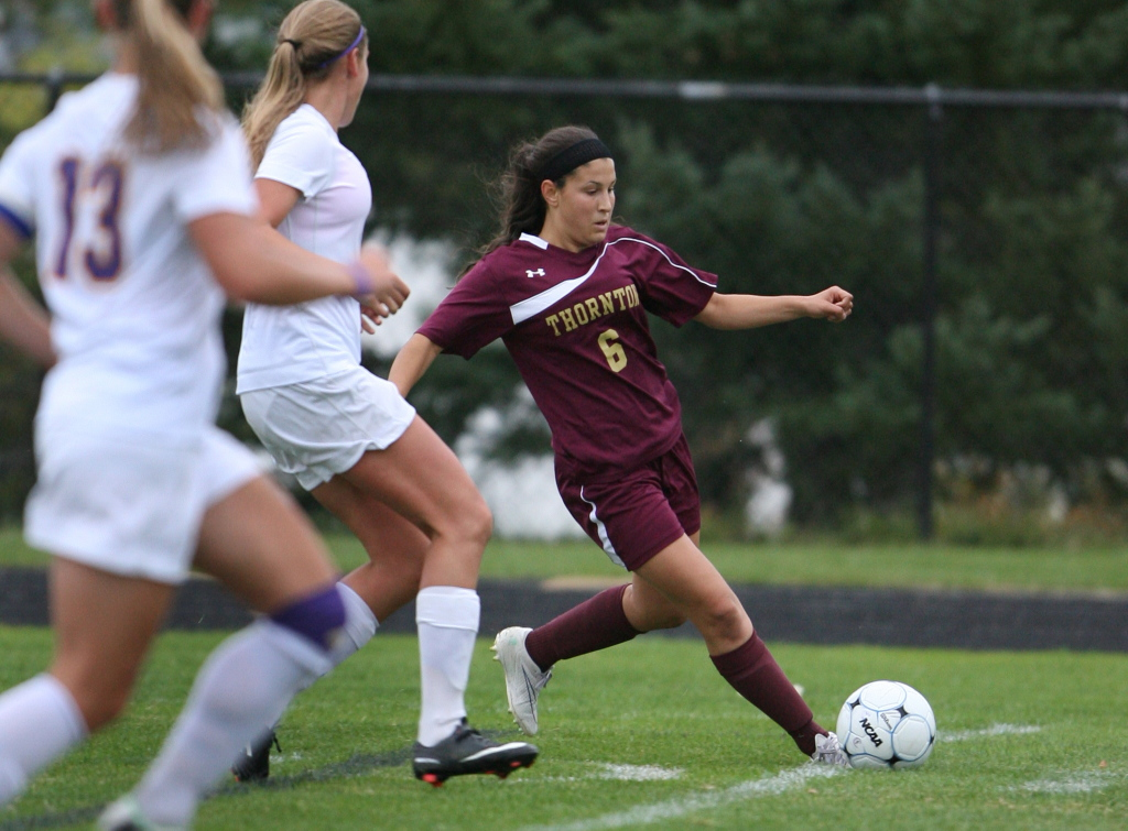 Thornton Academy's Haley DaGraca brings the ball down field in the first half Wednesday against Cheverus. DaGraca had a goal and an assist in Thornton's 6-0 win. Joel Page/Staff Photographer