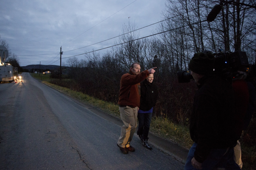 Ted Wilbur and Kaci Hickox take a walk near his house in Fort Kent on Friday.