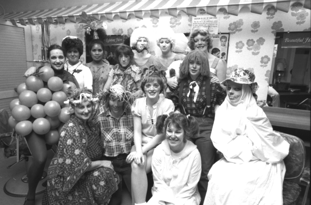 An uncredited photo of staff and students at Josephine's School of Hair Fashions at 449 Forest Avenue, in the Forest Avenue Plaza strip mall. This photo was unused in print, but another photo used in the Oct. 31, 1979 edition of the Portland Evening Express identifies the woman in the center (in curls and freckles) as Leslie Lint.