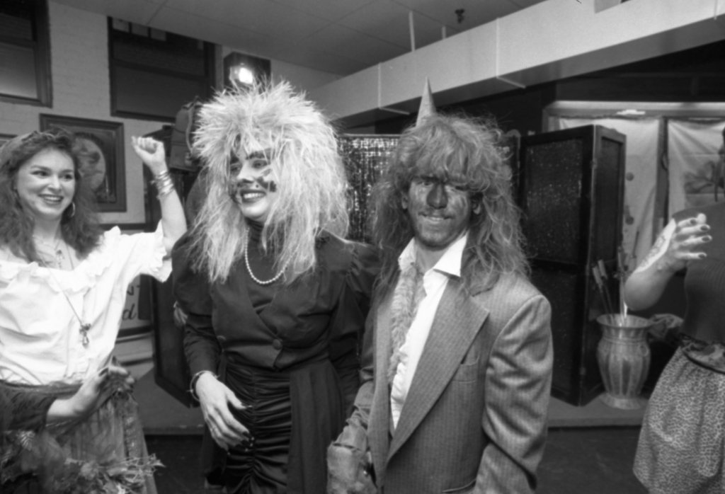 """Photo by Gordon Chibroski, from the Nov. 1, 1991 Portland Press Herald. Original caption: """"Christina Conant, dressed as 'the bride from hell,' exchanges vows with Skipper Wing, her werewolf groom, at a Halloween wedding. Looking on is her maid of honor, Sharon Nelmes."""""""