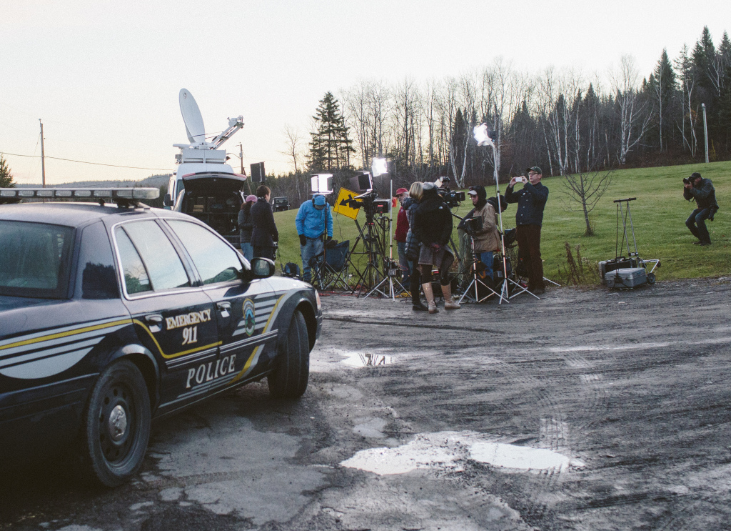 Maine State Police trooper vehicles, as well as members of national and local media stand outside the home of Ted Wilbur and Kaci Hickox in Fort Kent Thursday morning.