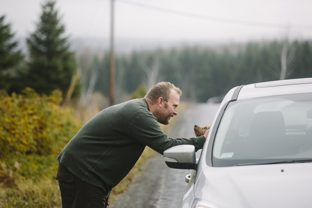 Ted Wilbur greets a passing car as he waits for the CDC to take his girlfriend, Kaci Hickox's temperature. She is being monitored to determine whether she is displaying symptoms of Ebola. Whitney Hayward/Staff Photographer