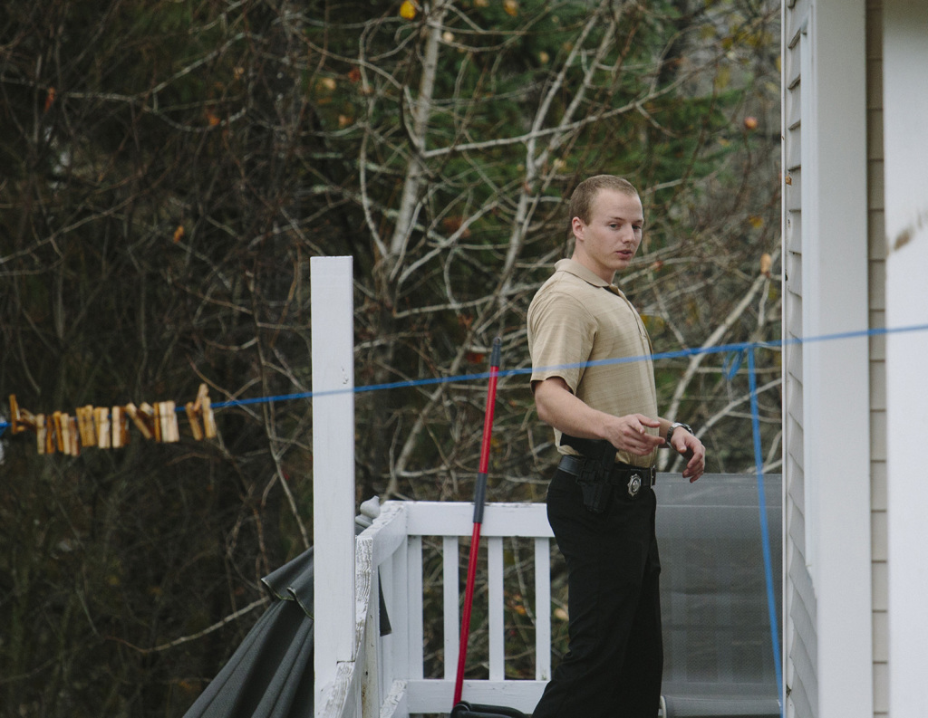 A Maine State police officer waits outside the home of Ted Wilbur, while a CDC employee assesses Kaci Hickox at her boyfriend Ted Wilbur's home in Fort Kent. Whitney Hayward/Staff Photographer