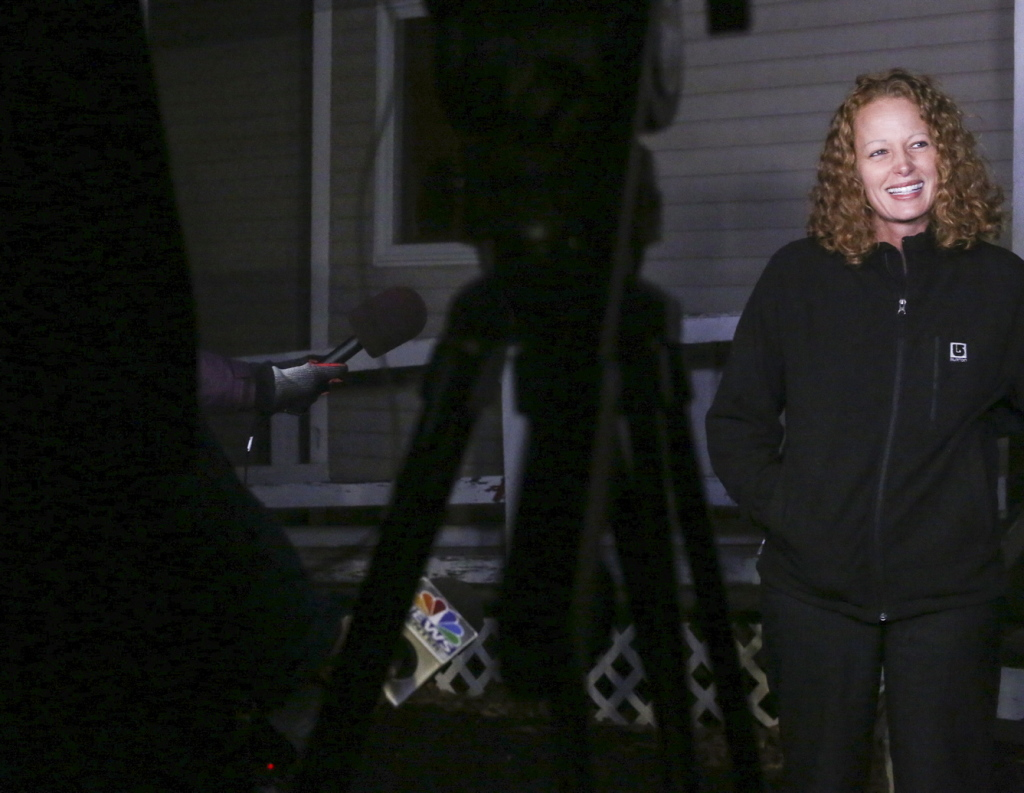"Kaci Hickox takes questions from reporters Wednesday night outside her boyfriend's home in Fort Kent. She said, ""We have been in negotiations all day with the state of Maine, and tried to resolve this amicably, but they will not allow me to leave my house and have any interaction with the public even though I'm completely healthy and symptom free."""