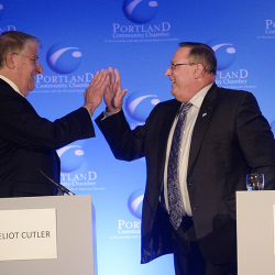 Eliot Cutler and Paul LePage high five each other during the debate at the Holiday Inn by the Bay in Portland Wednesday. Shawn Patrick Ouellette/Staff Photographer