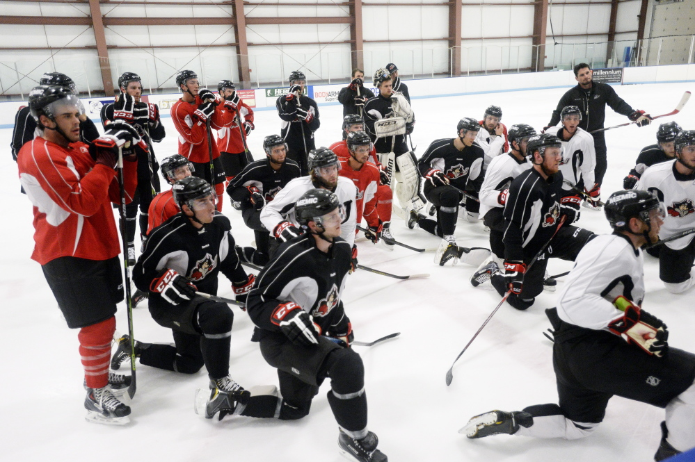 SACO, ME - SEPTEMBER 29: Portland Pirates players listen to their coach during the  first practice of the season Tuesday, September 30, 2014. (Photo by Shawn Patrick Ouellette/Staff Photographer)
