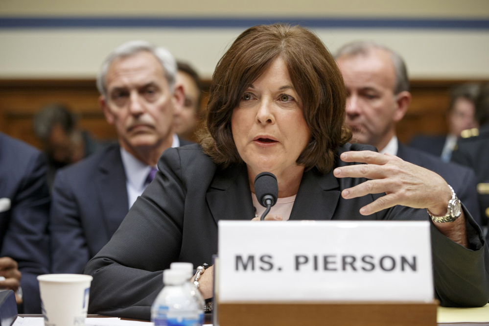 Julia Pierson testifies on Capitol Hill on Tuesday, one day before she resigned as Secret Service director because of a recent White House security breach.