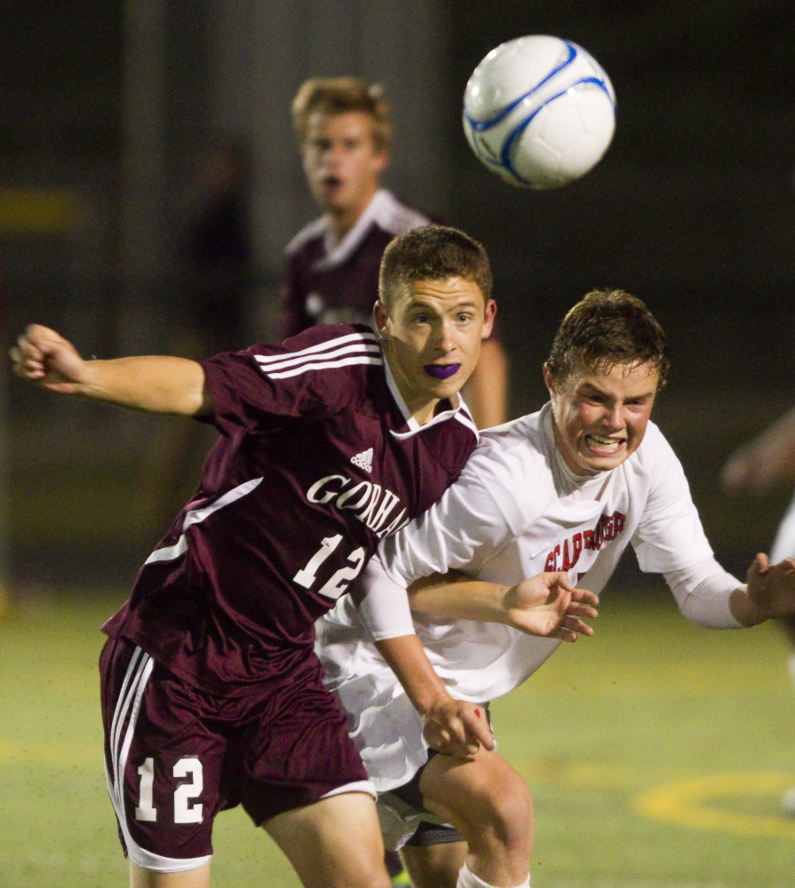 Thomas Brent of Gorham, left, and Josh Morrissey of Scarborough compete for a loose ball Thursday night during their SMAA boys' soccer game at Scarborough High. Each team remained undefeated with a 1-1 tie.