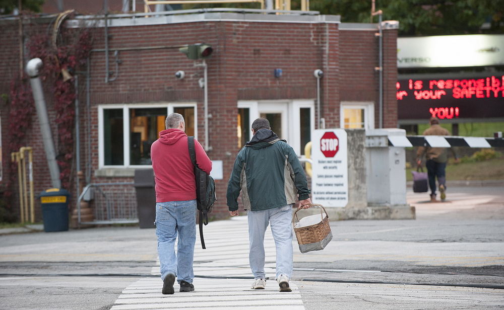 Workers enter the Verso mill in Bucksport on Thursday morning. Verso announced Wednesday that it will close the mill and lay off more than 500 workers in December.   Kevin Bennett Photo