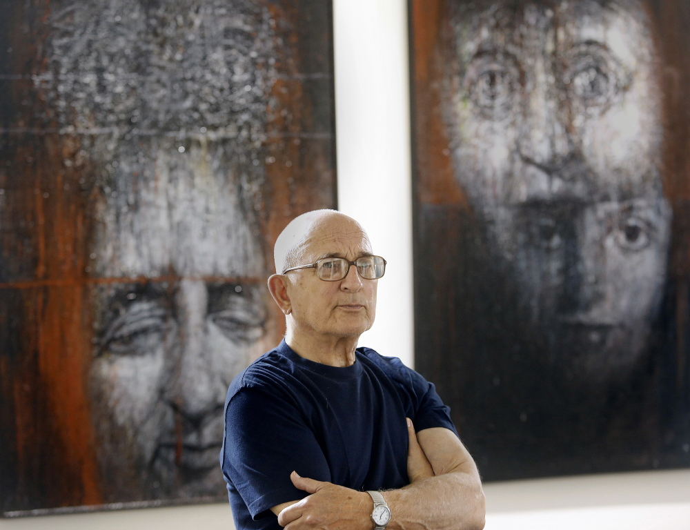 """Leonard Meiselman poses during the installation of """"The Dilemma of Memory"""" at the Holocaust and Human Rights Center of Maine in Augusta."""