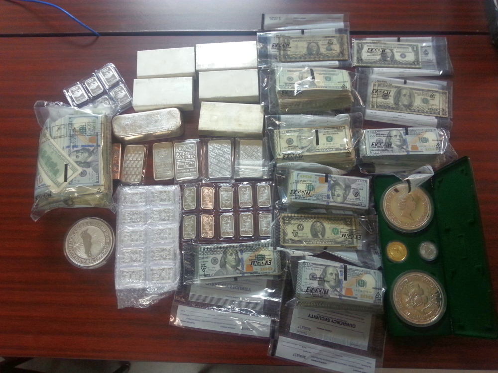 Shown is cash seized by authorities Thursday as part of an investigation into a theft ring.