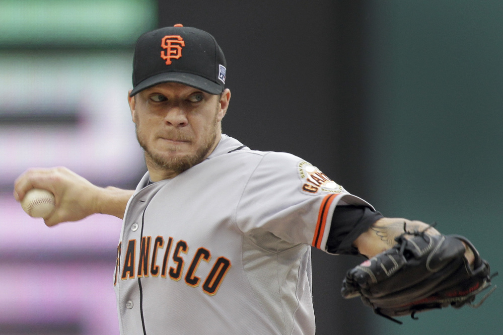 San Francisco Giants starting pitcher Jake Peavy throws in the second inning of Game 1 of the NL Division Series game against the Washington Nationals on Friday in Washington.