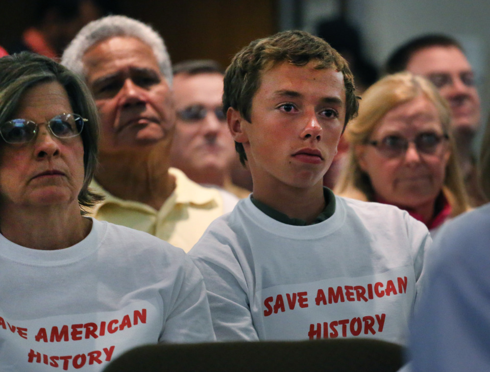 Members of the public attend Jefferson County School Board meeting, which heard testimony from members of the public weighing in on the school board's controversial proposal to emphasize patriotism and downplay civil unrest in the teaching of U.S. history, in Golden, Colo., Thursday. The Associated Press