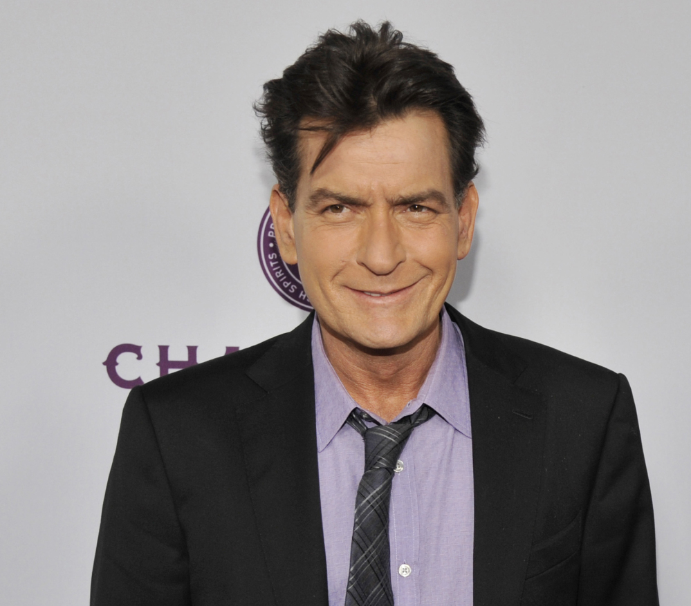 Charlie Sheen is being sued by a dental technician who claims he punched her and grabbed her bra.