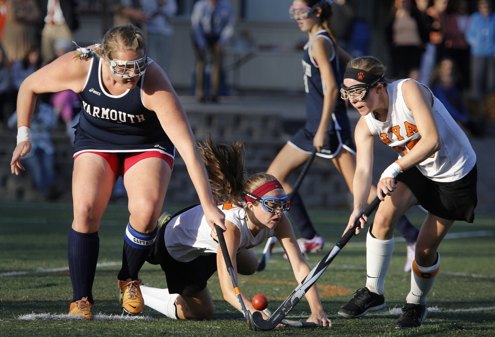 Meaghan Gorman of Yarmouth tries to knock the ball away from Marina Poole, right, of North Yarmouth Academy during Friday's game at NYA. North Yarmouth handed Yarmouth its first loss, 2-1 in overtime.