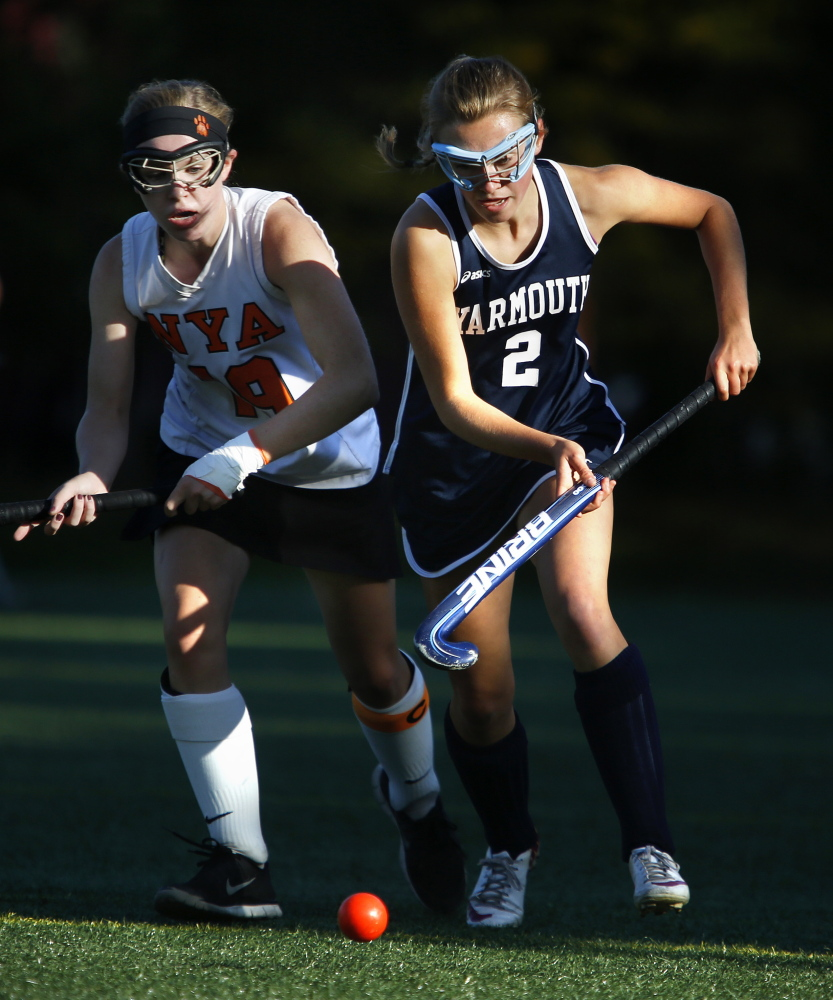 Georgia Giese of Yarmouth pushes the ball ahead while being chased by Marina Poole of North Yarmouth Academy. Poole's goal in overtime enabled NYA to improve its record to 9-2, while Yarmouth dropped to 10-1.