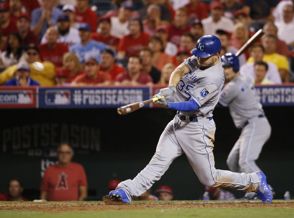 Kansas City' Eric Hosmer hits a game-winning two-run home run against the Los Angeles Angels in the 11th inning of Game 2 of the AL Division Series on Friday night in Anaheim, Calif.