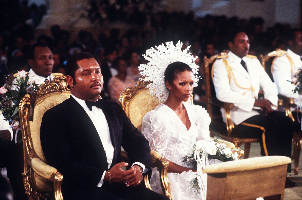 Then-Haitian president Jean-Claude Duvalier is pictured with his bride,  Michele Bennett, during their wedding ceremony in 1980.