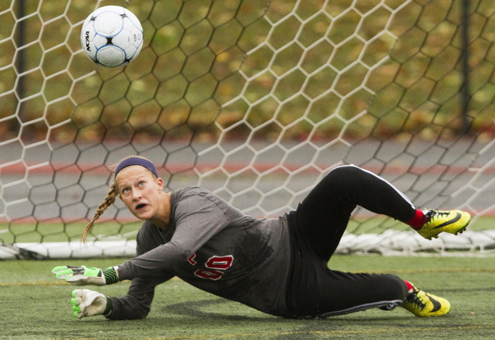 Emma Russell of South Portland keeps her eyes on the ball after diving to make a save Saturday during the girls' soccer game against Portland at Fitzpatrick Stadium. Russell finished with eight saves for the Red Riots in a 1-0 setback.
