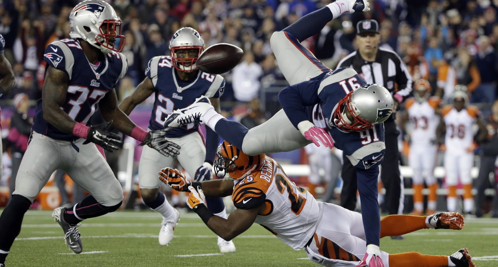 Bengals running back Giovani Bernard, bottom, upends Patriots linebacker Jamie Collins, right, who fumbles. New England cornerback  Alfonzo Dennard, left, ended up with the ball.