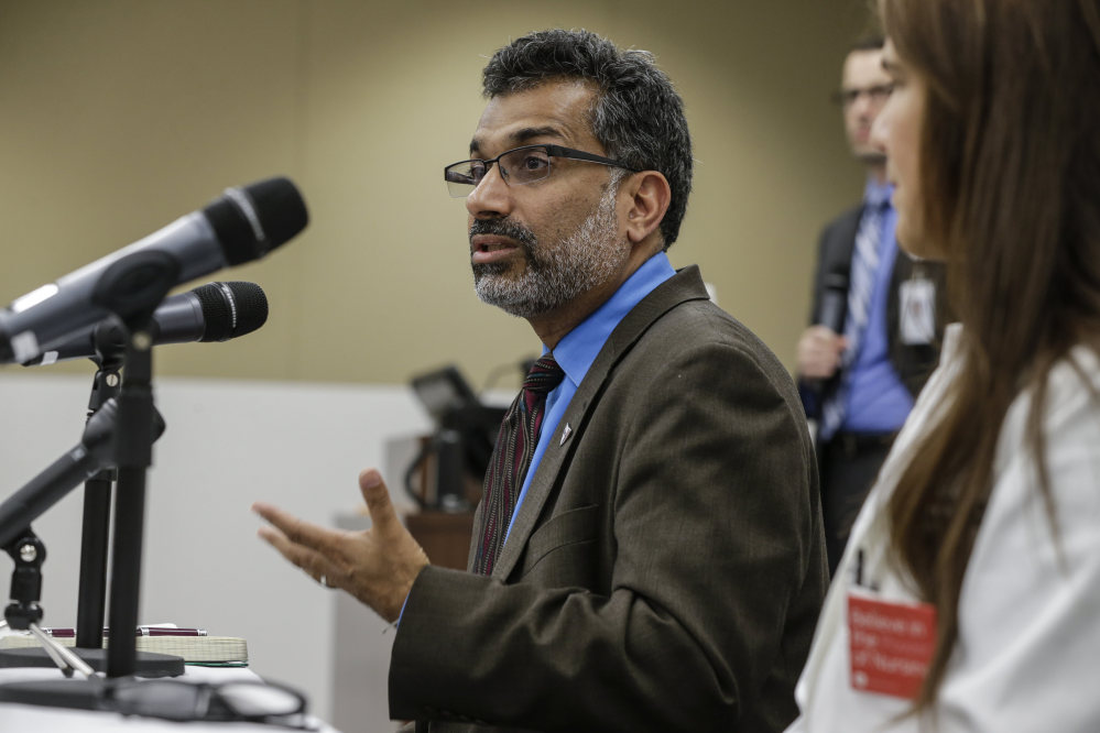 Dr. Ali Khan, Dean of the College of Public Health at the Nebraska Medical Center, speaks during a news conference in Omaha, Neb., Friday to discuss Ebola patient, journalist Ashoka Mukpo, who is expected to arrive from Liberia at the Medical Center on Monday.)