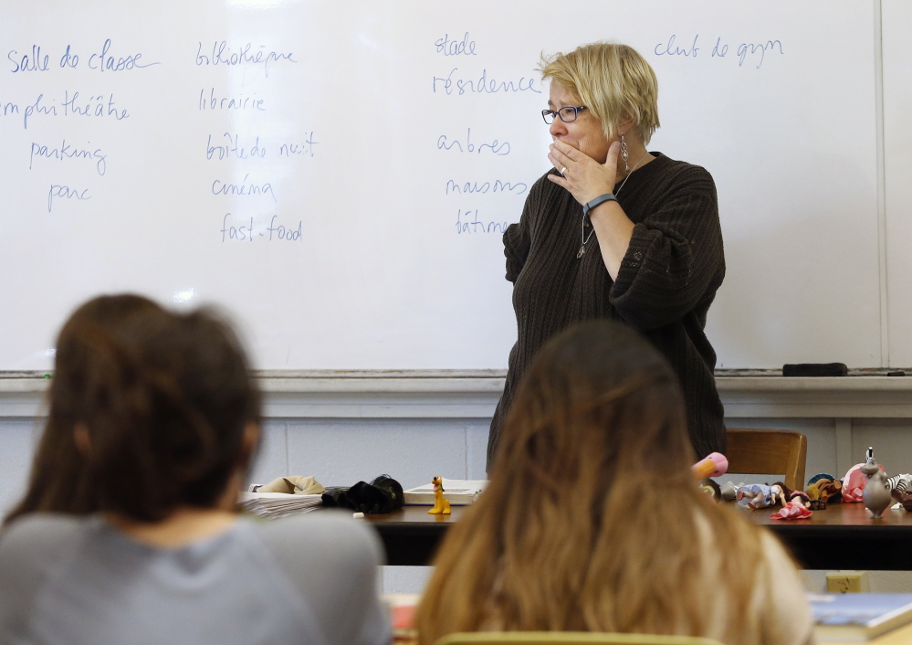 "Nancy Erickson, who has taught at USM for 18 years, is briefly overcome by emotion during her French class Monday after learning that the undergraduate French program is targeted for elimination. ""I'm a little bit shocked,"" she said in an interview."