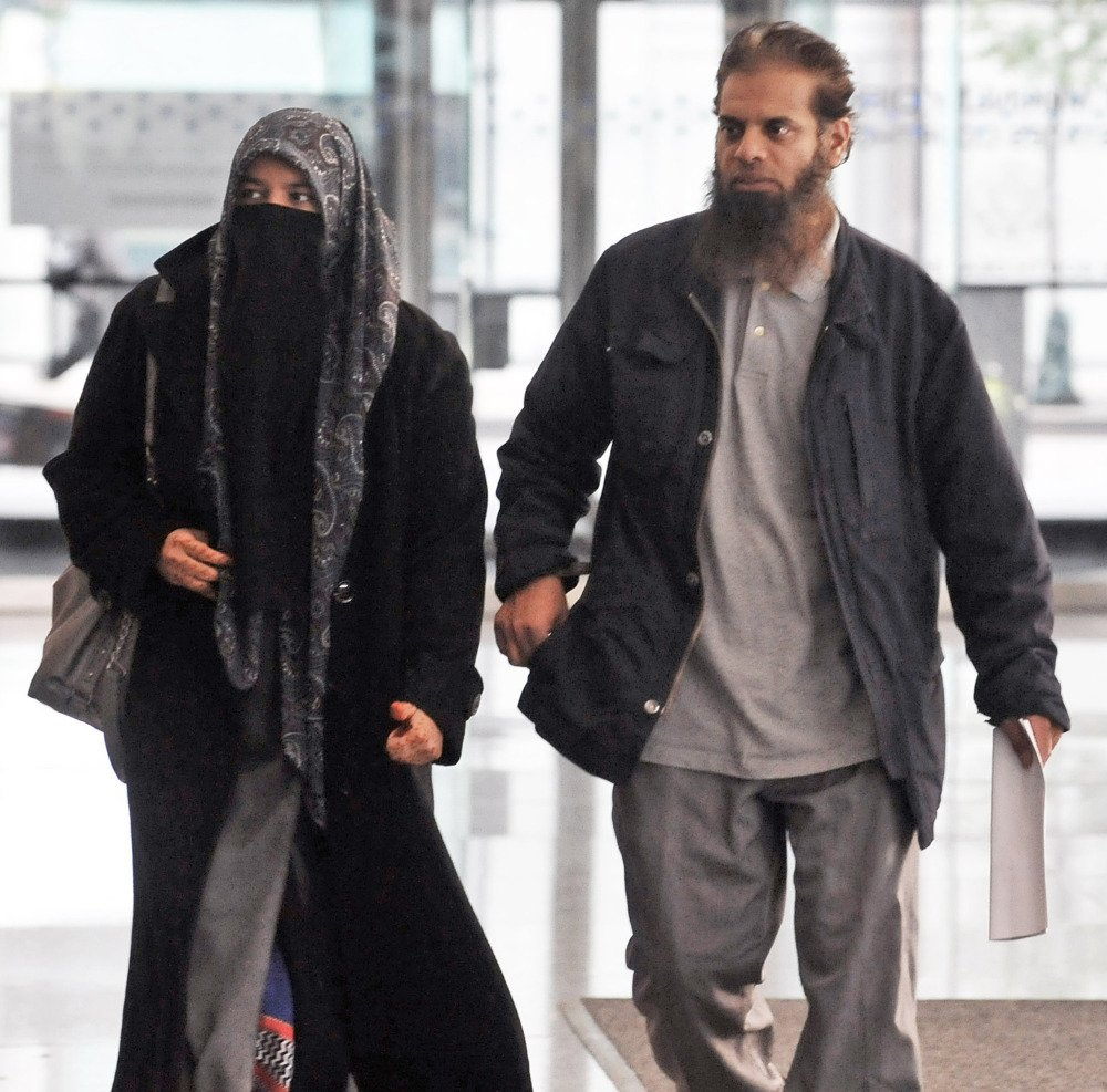 The parents of Mohammed Hamzah Khan, a 19-year-old U.S. citizen from Bolingbrook, Ill., leave the Dirksen federal building Chicago on Monday. Their son, Mohammed Hamzah Khan, was arrested Saturday at O'Hare International Airport, from where he intended to fly to Turkey so he could sneak into Syria to join the Islamic State, according to a criminal complaint released Monday.