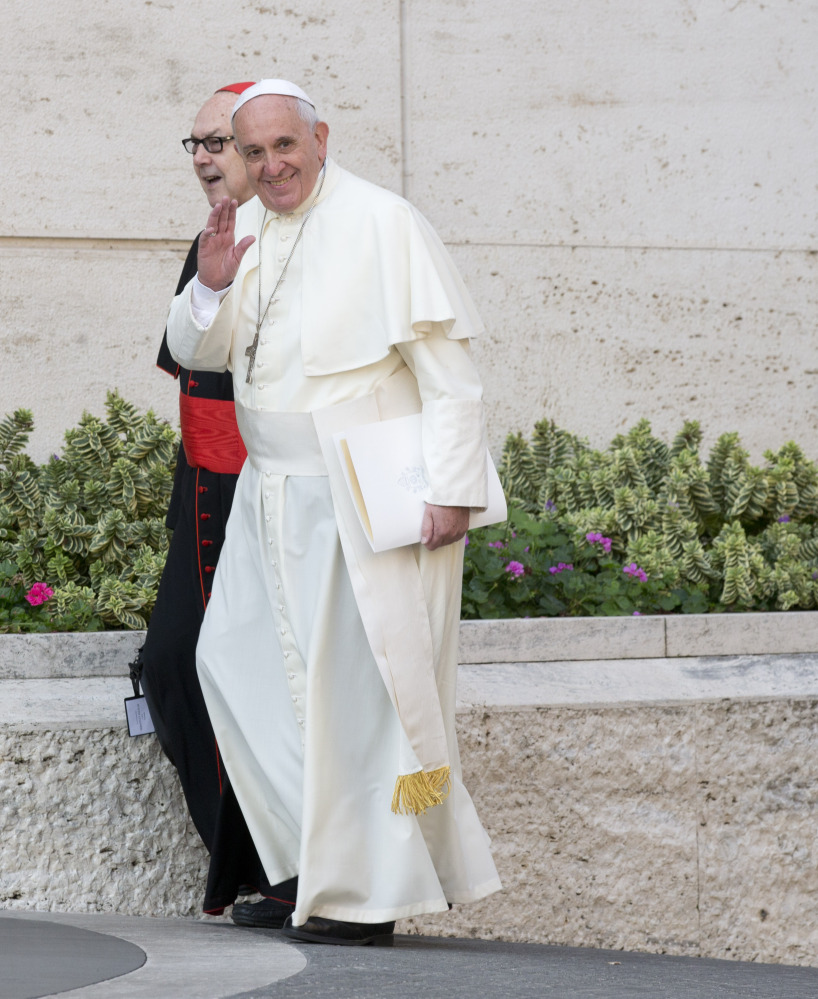 Pope Francis, with Cardinal Fernando Sebastian Aguilar, arrives at a morning session of a two-week synod on family issues at the Vatican on Tuesday.