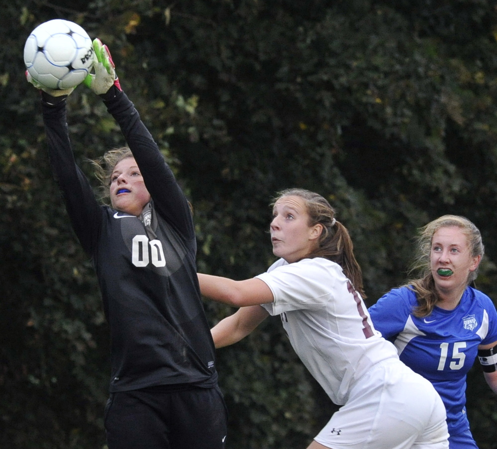 Kennebunk goalie Kyra Schwartzman makes a save as Greely's Allison Coon and Kennebunk's Ally Weaver attempt to make a play in Tuesday's game. Greely won, 5-0.