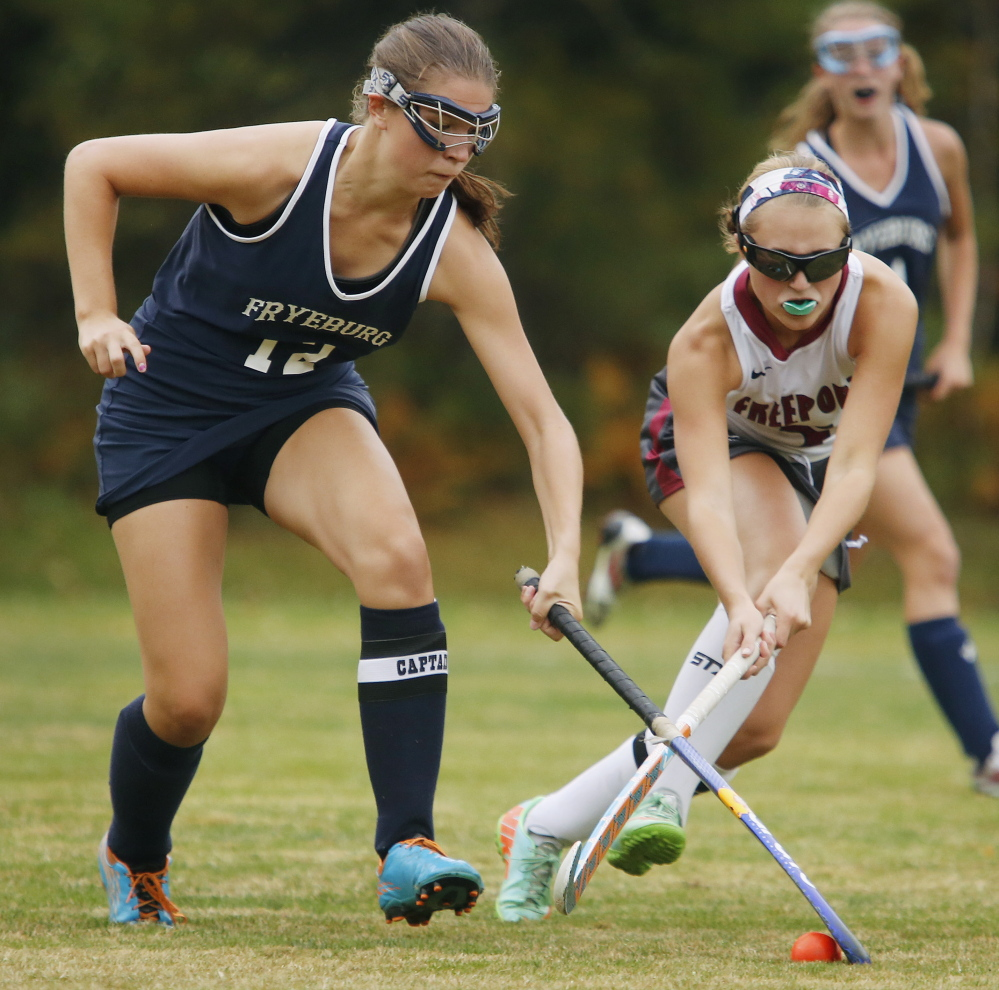 Mackenzie Hill of Fryeburg Academy, left, pulls the ball away from Hannah Williams of Freeport during their scoreless tie Tuesday in a Western Maine Conference field hockey game at Freeport.
