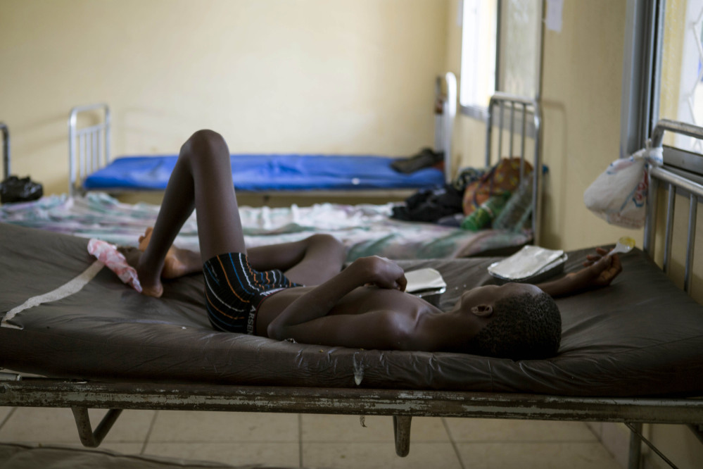 A child suffering from the Ebola virus receives treatment at Makeni Arab Holding Centre in Makeni, Sierra Leone, Saturday.