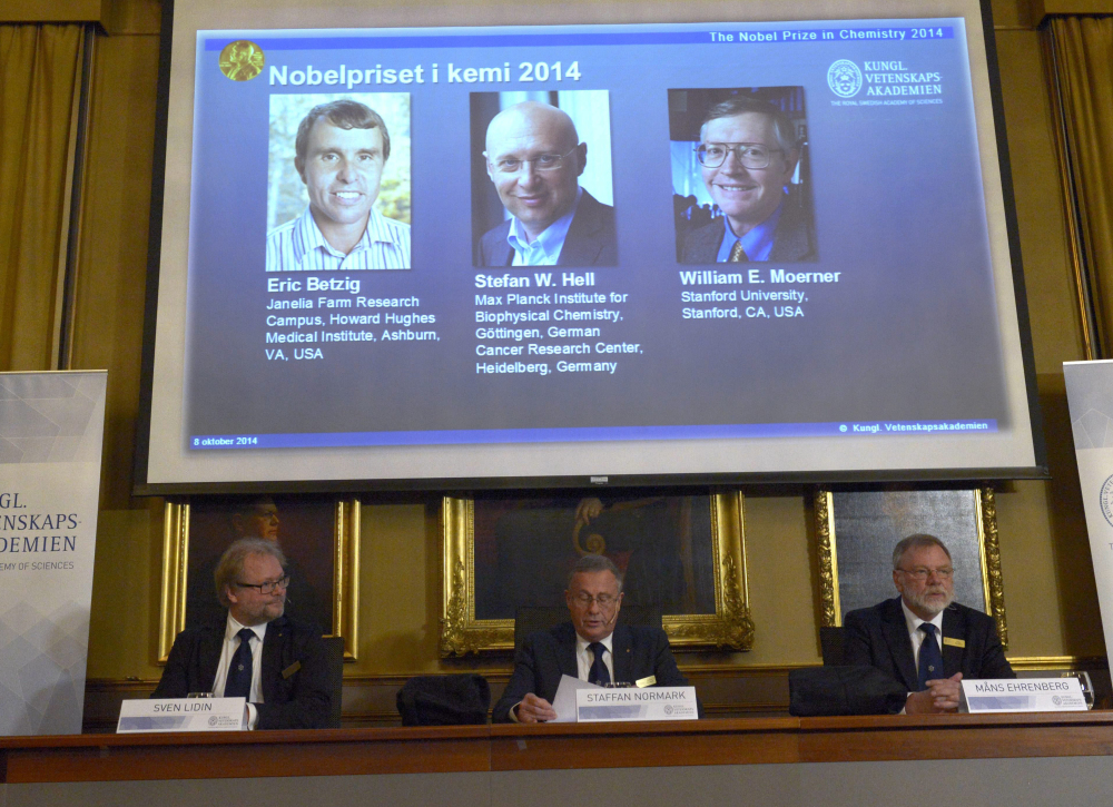 """Sven Lidin, left , Staffan Nordmark, centre,  and Mans Ehrenberg at the  Royal Academy of Sciences  Wednesday, announce the Nobel Chemistry laureates 2014. Americans Eric Betzig and William Moerner and German scientist Stefan Hell  won the Nobel Prize in Chemistry for """"the development of super-resolved fluorescence microscopy."""""""