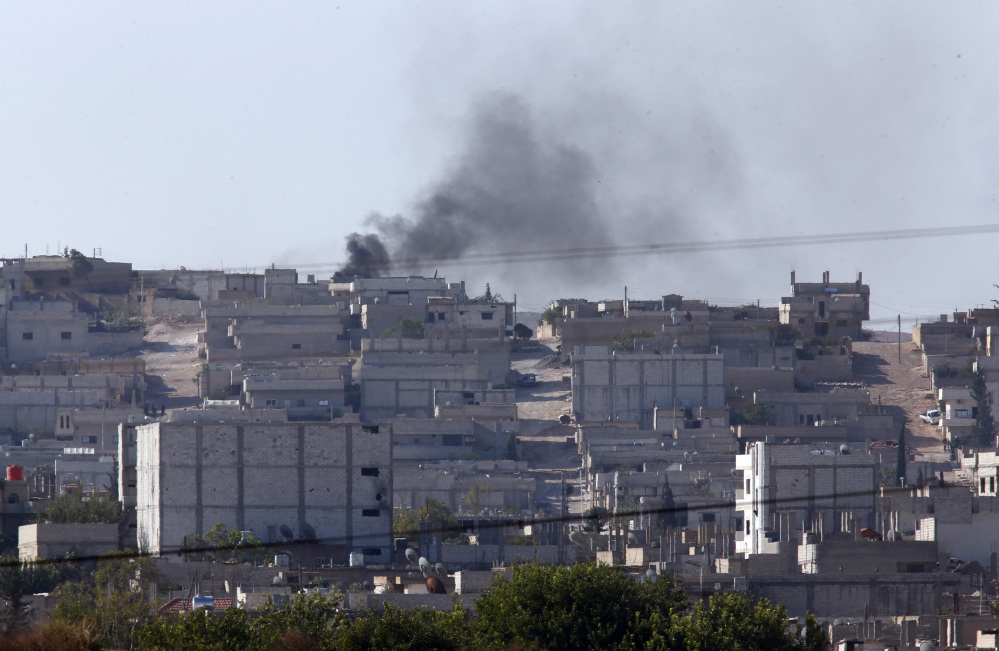 Smoke rises after a strike in Kobani, Syria as fighting intensifies between Syrian Kurds and the militants of Islamic State group, as seen from Mursitpinar on the outskirts of Suruc, at the Turkey-Syria border,  Wednesday.