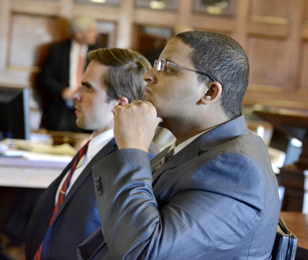 Anthony Pratt Jr., right, listens with one of his attorneys, Dylan Boyd, during closing arguments in his murder trial at the Cumberland County Courthouse in Portland on Wednesday.