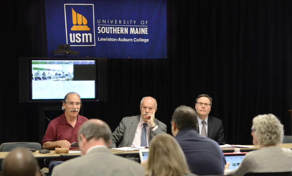USM Faculty Senate Chairman Jerry LaSala, left, speaks as the university's President David Flanagan, center, and Provost Joe McDonnell listen during a Faculty Senate meeting in Lewiston on Friday. Proposals to shut a campus and improve retirement incentives were discussed.