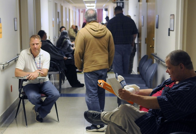 Veterans line up to receive medical care during the Homeless Veterans Stand Down at the Togus veterans' hospital in October 2014. A rule change proposed by the Department of Veterans Affairs would reduce wait times for veterans to receive care.