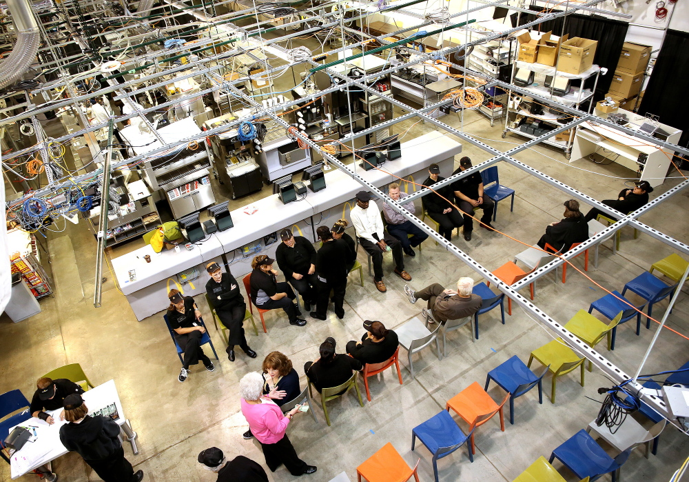 Workers await tasks at McDonald's 38,000-square-foot Innovation Center in Romeoville, Ill. Eighty crew members and five managers work in the warehouse's test restaurants.