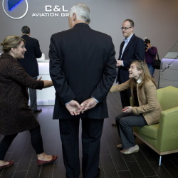 Sarah Smiley, left, communications director with C&L Aviation Group in Bangor, meets Lizzy Reinholt, communications director for U.S. Rep. Mike Michaud, center.