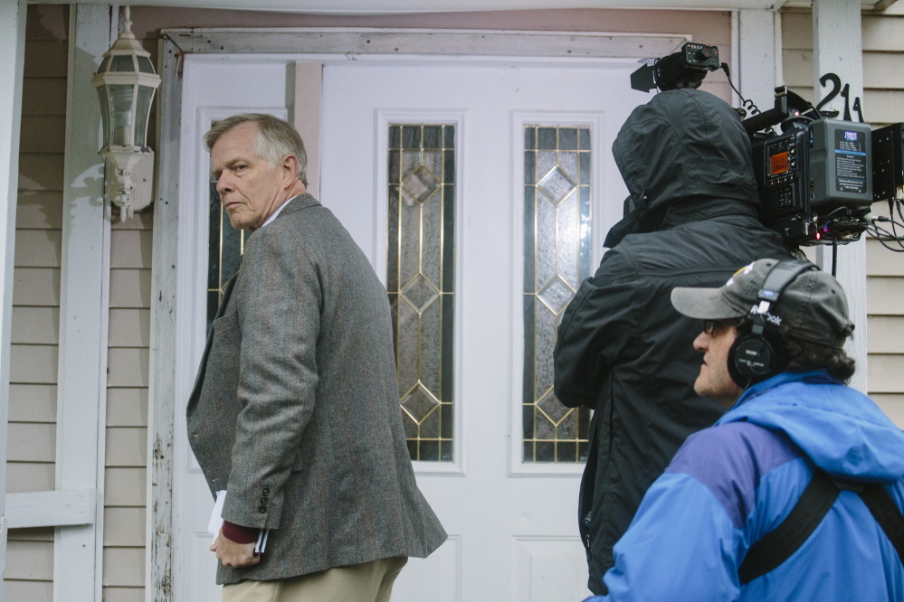 NBC affiliate network producer Nick Bogert, left, video photojournalist Joel Coblenz, center, and audio technician Paul Green knock on the home of Ted Wilbur, where Kaci Hickox returned Tuesday evening in Fort Kent, ME on Wednesday. Whitney Hayward/Staff Photographer