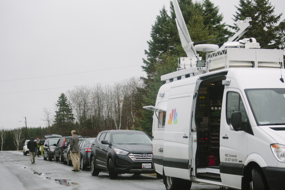 Members of the media line up outside Ted Wilbur's home, where Kaci Hickox returned on Tuesday night, in Fort Kent, ME on WednesdayWhitney Hayward/Staff Photographer