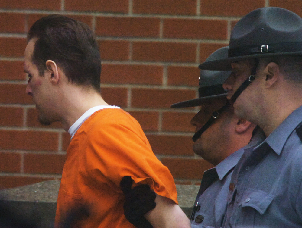 Suspected killer Eric Frein is led into the Pike County Courthouse by Pennsylvania State Troopers for his preliminary hearing on Friday.