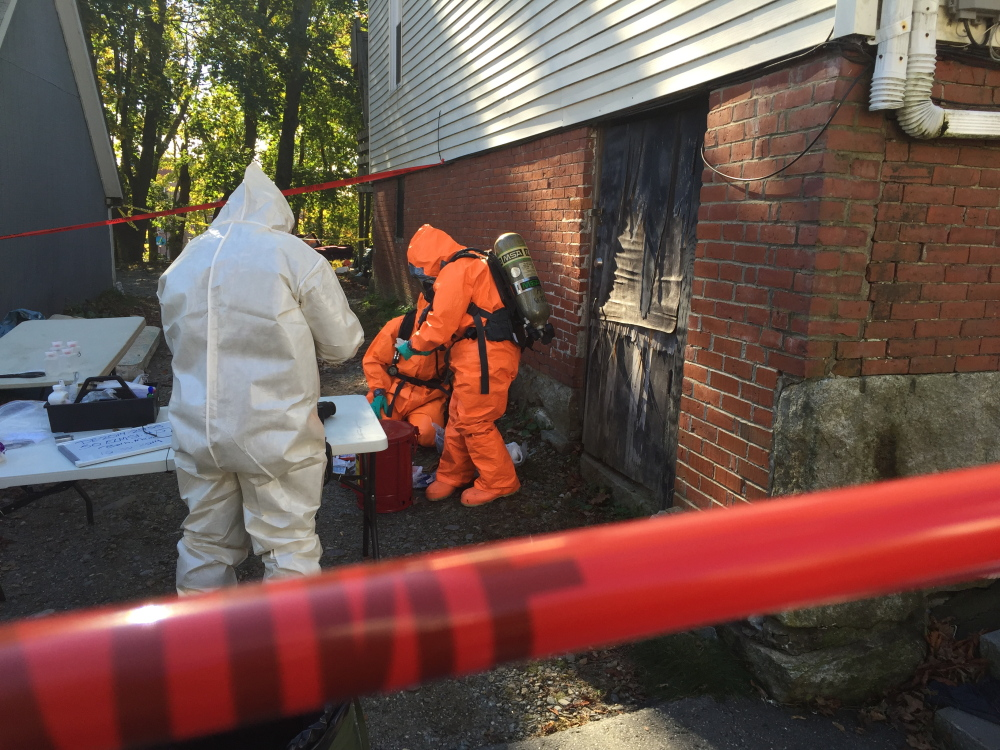 Agents work at the site where police said they found a meth lab.