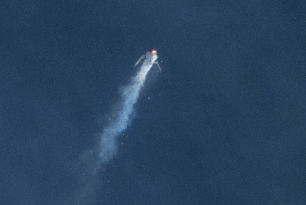 The Virgin Galactic SpaceShipTwo rocket explodes in the air during a test flight on Friday over Southern California's Mojave Desert.