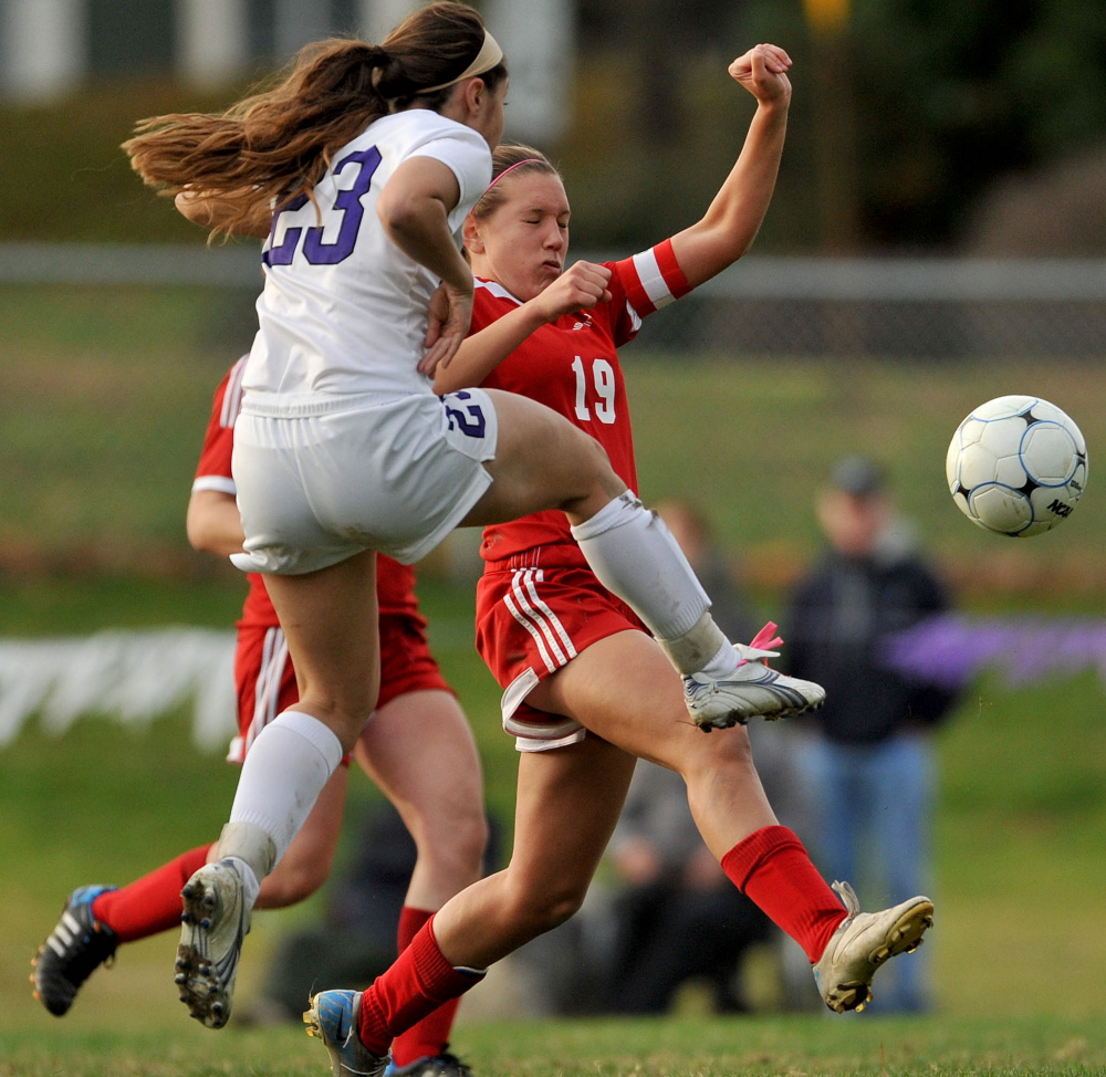 Pilar Elias of Waterville contends for the ball with Hannah Wincklhofer of Camden Hills in the second half. Waterville will take a 16-0 record into the regional final Wednesday at home against Hermon or Presque Isle.