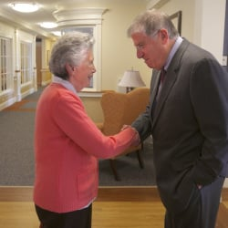 Cutler talks with Phyllis Goss of Glenburg at the Sylvia Ross home in Bangor . Goss was at the home visiting a friend.